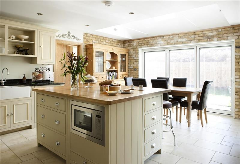 Island with a mix of neptune kitchen cabinets for a bespoke look