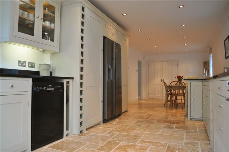 13 Full height larder cabinets provide ample storage space and look stunning wither side of an American fridge