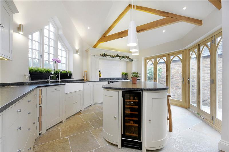 8 The curved base cabinets of the centre island balance out the contemporary angles of this stunning kitchen