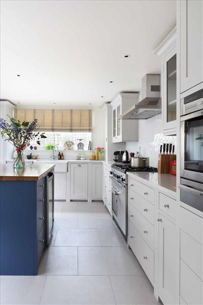 5 A bright and contemporary Neptune Suffolk kitchen with a stunning cobalt blue island providing plenty of drawer space
